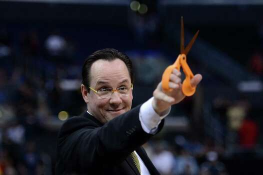 LOS ANGELES, CA - MARCH 30:  Head coach Gregg Marshall of the Wichita State Shockers holds up a pair of scissors before cutting down the net after defeating the Ohio State Buckeyes 70-66 during the West Regional Final of the 2013 NCAA Men's Basketball Tournament at Staples Center on March 30, 2013 in Los Angeles, California. Photo: Harry How, Getty Images / 2013 Getty Images