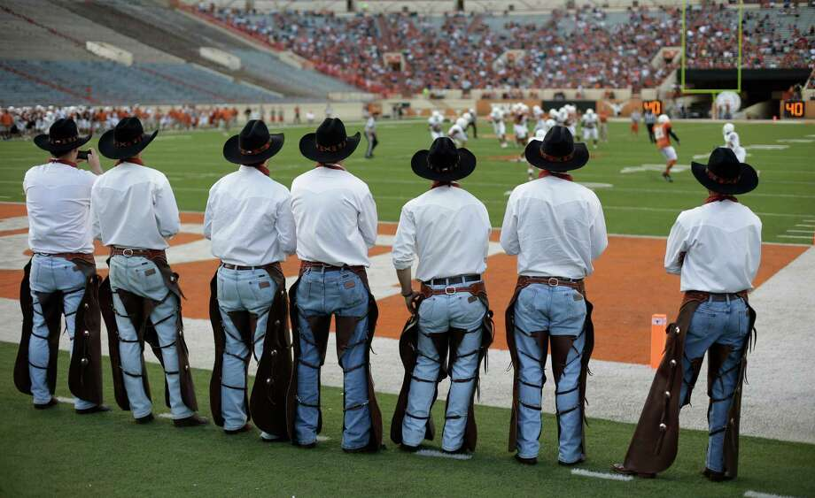 Members of the Texas Cowboys watch Texas' spring NCAA college football game, Saturday, March 30, 2013, in Austin, Texas. (AP Photo/Eric Gay) Photo: Eric Gay, Associated Press / AP