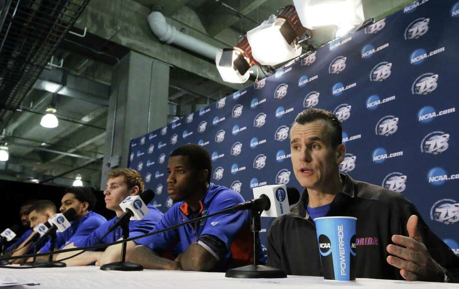 Florida coach Billy Donovan and his team answer questions Saturday. The Gators are in a third straight Elite Eight because of their defense, which runs contrary to how Donovan was as a player. Photo: David J. Phillip / Associated Press