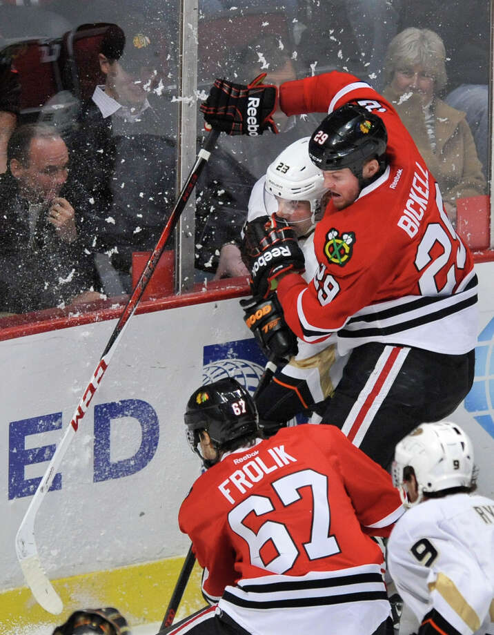 Chicago Blackhawks' Bryan Bickell right, checks Dave Anaheim Ducks' Francois Beauchemin left, during the third period of an NHL hockey game in Chicago, Friday, March, 29, 2013. Anaheim won 2-1. (AP Photo/Paul Beaty) Photo: PAUL BEATY