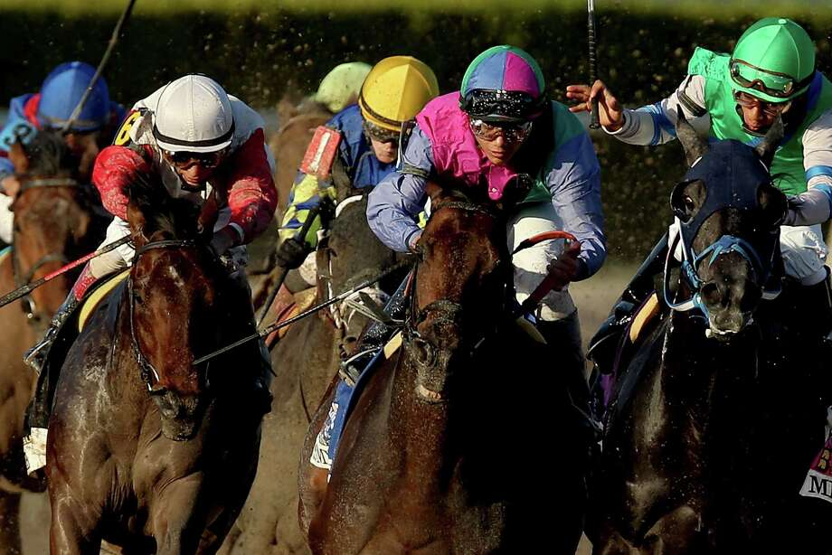 HALLANDALE, FL - MARCH 30:  Orb #6 (L), riden by John Velazquez, comes aound turn four behind Itsmyluckyday #3, riden by Elvis Trujillo, and Narvaez #10, riden by Rajiv Maragh, during the Florida Derby at Gulfstream Park on March 30, 2013 in Hallandale, Florida.  (Photo by Matthew Stockman/Getty Images) Photo: Matthew Stockman