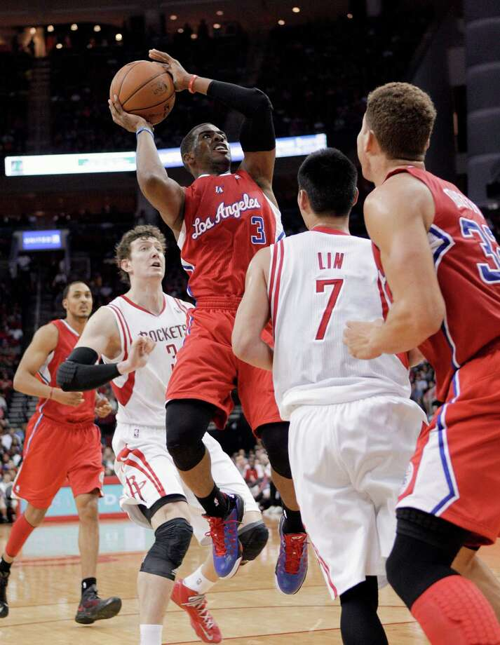 Los Angeles Clippers guard Chris Paul (3) shoots over Houston Rockets guard Jeremy Lin (7) during the first half of an NBA basketball game Saturday, March 30, 2013, in Houston. (AP Photo/Bob Levey) Photo: BOB LEVEY