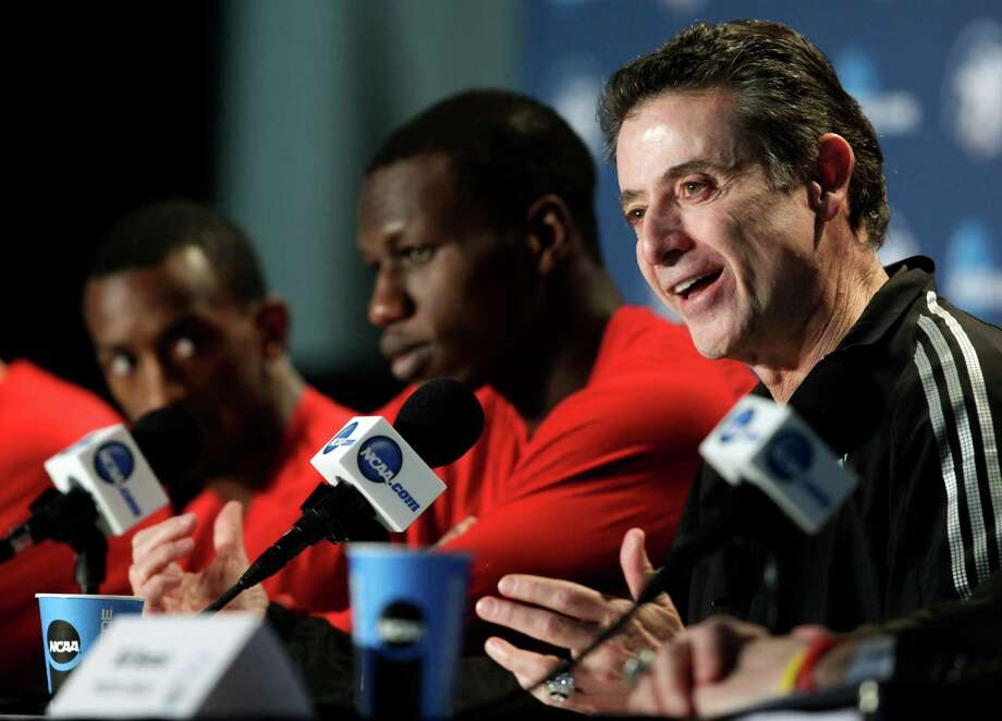 Louisville head coach Rick Pitino talks to reporters during a news conference, Saturday, March 30, 2013, in Indianapolis. Louisville is scheduled to play Duke in the Midwest Regional final in the NCAA college basketball tournament on Sunday. (AP Photo/Kiichiro Sato) Photo: Kiichiro Sato