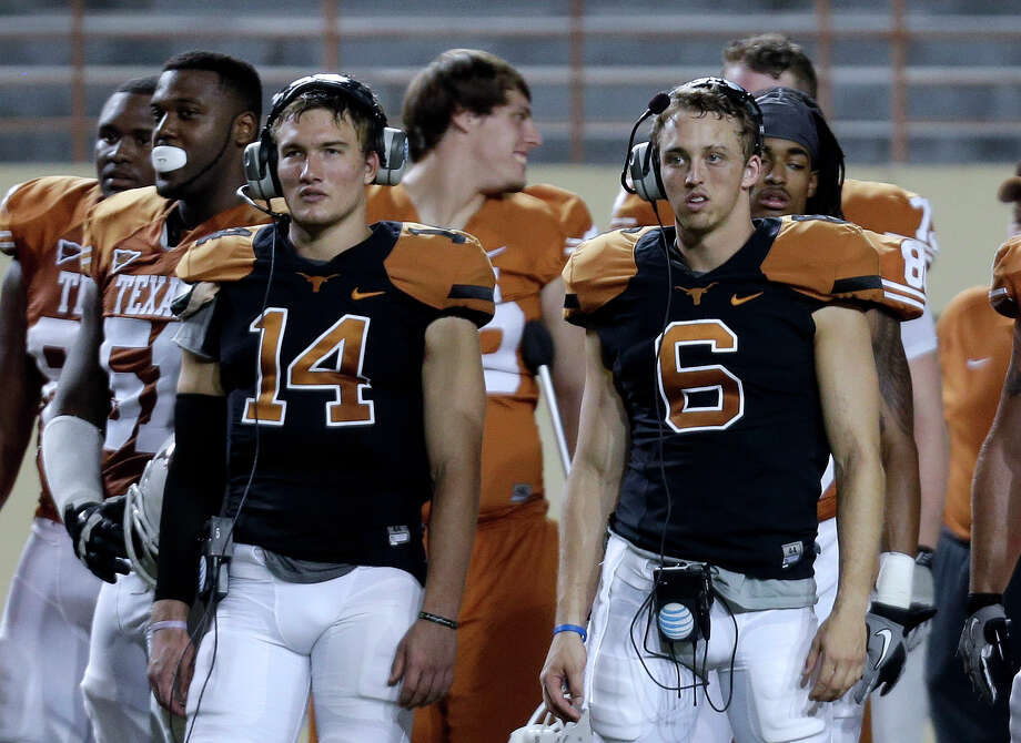 Texas quarterbacks David Ash (14) and Case McCoy (6) help with signal calling from the sideline during the team's intersquad spring football game, Saturday, March 30, 2013, in Austin, Texas. (AP Photo/Eric Gay) Photo: Eric Gay, Associated Press / AP