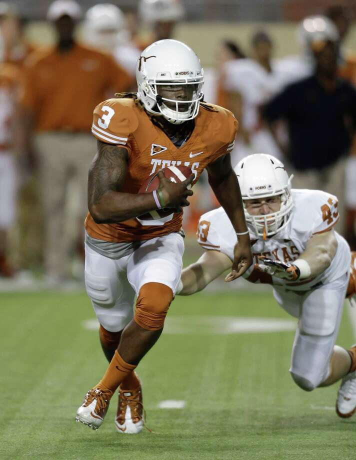 Texas quarterback Jalen Overstreet (3) gets away from Texas defender Logan Mills (43) during the NCAA college football team's spring game, Saturday, March 30, 2013, in Austin, Texas. (AP Photo/Eric Gay) Photo: Eric Gay, Associated Press / AP