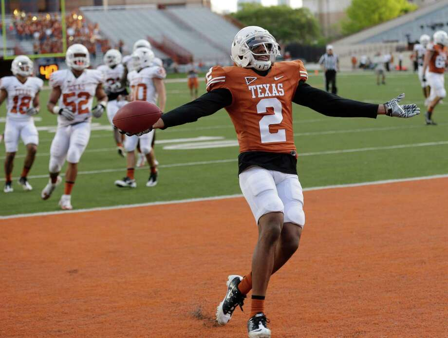 Texas' Kendall Sanders reacts after he scored during the NCAA college football team's spring game, Saturday, March 30, 2013, in Austin, Texas. (AP Photo/Eric Gay) Photo: Eric Gay, Associated Press / AP
