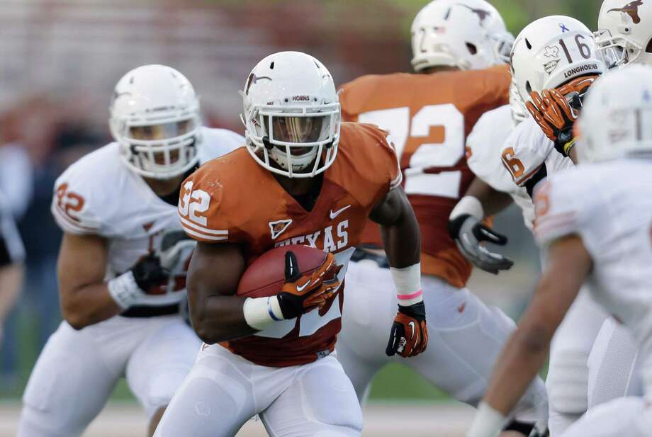 Texas running back Jonathan Gray (32) carries the ball during the NCAA college football team's spring game, Saturday, March 30, 2013, in Austin, Texas. (AP Photo/Eric Gay) Photo: Eric Gay, Associated Press / AP