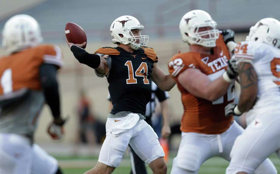 Texas quarterback David Ash (14) throws a pass during the NCAA college football team's spring game, Saturday, March 30, 2013, in Austin, Texas. (AP Photo/Eric Gay) Photo: Eric Gay, Associated Press / AP