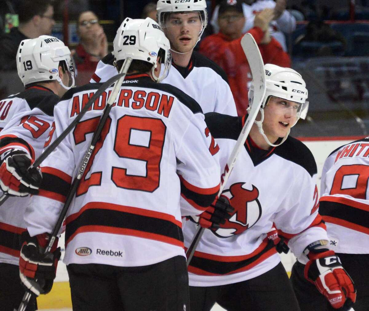 Albany Devils' #20 Reid Boucher, at right, and team mates celebrate his first period goal during Saturday's game against the Portland Pirates at the Times Union Center in Albany March 30, 2013. (John Carl D'Annibale / Times Union)