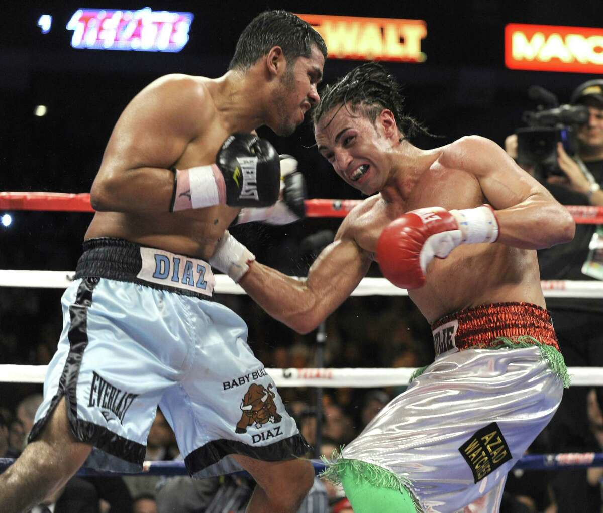 Juan 'Baby Bull' Diaz (left), fighting Paulie Malignaggi in 2009, will fight Pipino Cuevas Jr. on April 13 at Corpus Christi's American Bank Center in his first bout after a two-year retirement.