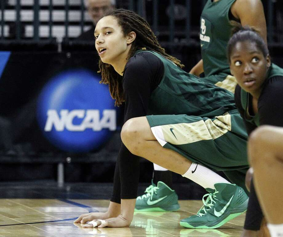 Baylor's Brittney Griner, stretching at practice Saturday, and her teammates prepare for games any way they like because coach Kim Mulkey stays out of the locker room before games. Photo: Sue Ogrocki / Associated Press