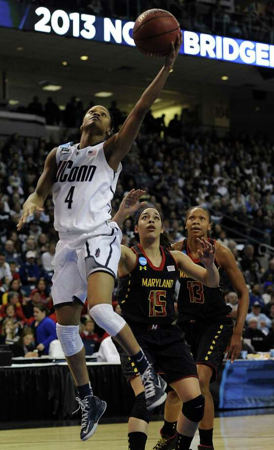 Connecticut's Moriah Jefferson, driving by Maryland's Chloe Pavlech (15) and Alicia DeVaughn, is one of three freshmen who led the Huskies on Saturday. Photo: John Woike / McClatchy-Tribune News Service