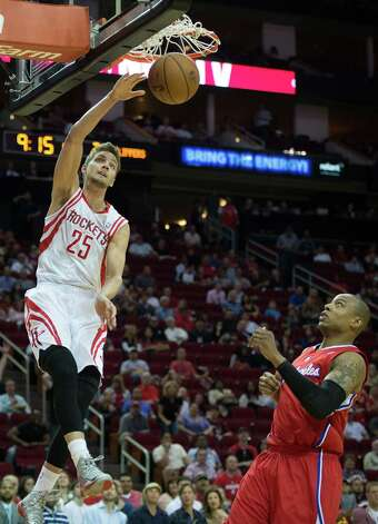 Rockets small forward Chandler Parsons slams home two of his 15 points over Clippers small forward Caron Butler during the first half. Photo: Smiley N. Pool, Houston Chronicle / © 2013  Houston Chronicle