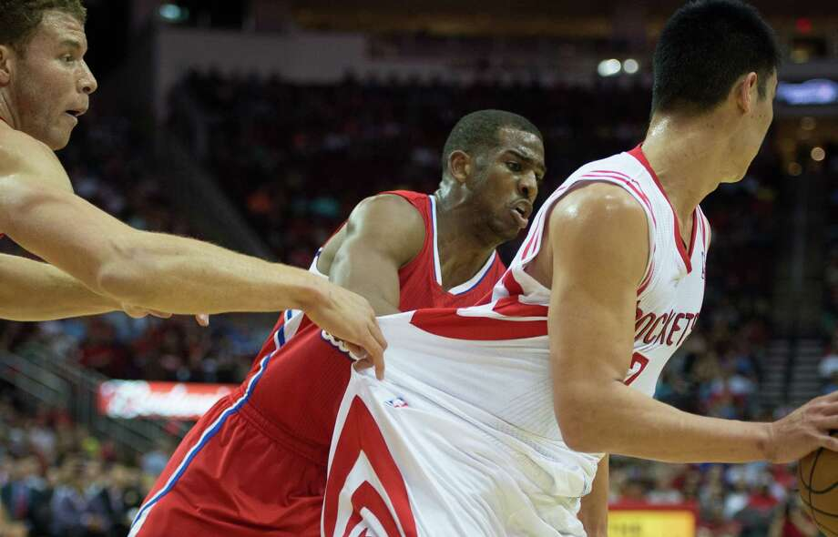 Clippers power forward Blake Griffin grabs the jersey of Houston Rockets point guard Jeremy Lin as point guard Chris Paul applies pressure. Photo: Smiley N. Pool, Houston Chronicle / © 2013  Houston Chronicle
