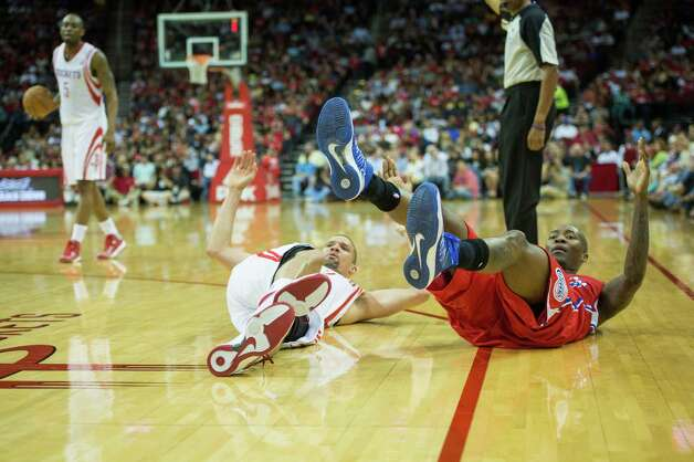 Rockets guard Francisco Garcia tumbles to the floor as he is fouled by  Clippers guard Jamal Crawford. Photo: Smiley N. Pool, Houston Chronicle / © 2013  Houston Chronicle