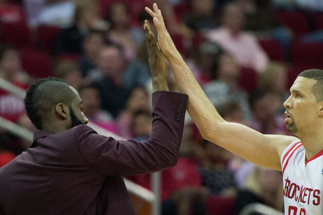 Rockets guard Francisco Garcia gets a high five from James Harden during the first half. Harden sat out the game with soreness in his right foot. Photo: Smiley N. Pool, Houston Chronicle / © 2013  Houston Chronicle