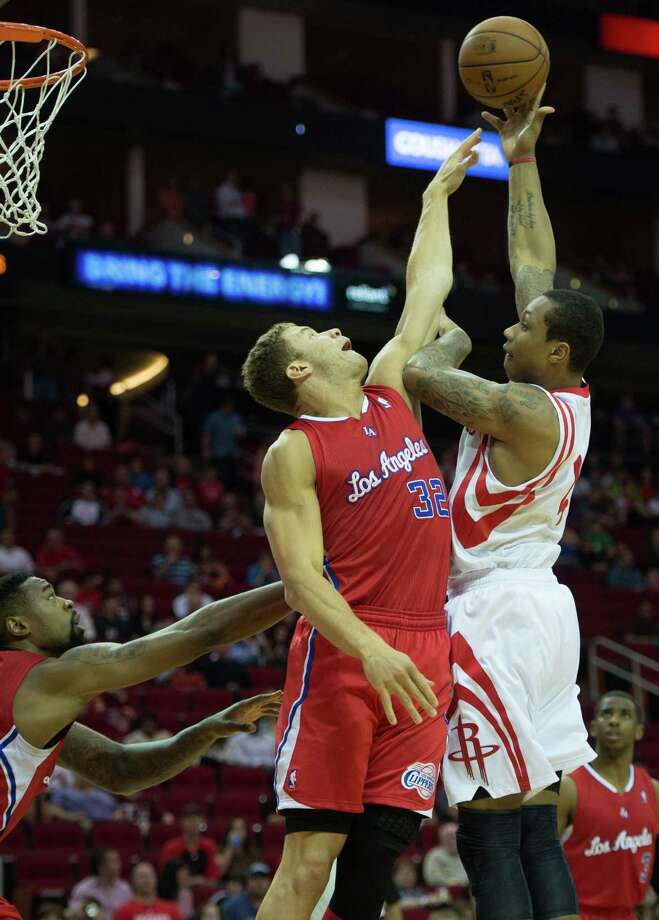 Rockets power forward Greg Smith shots over Clippers power forward Blake Griffin. Photo: Smiley N. Pool, Houston Chronicle / © 2013  Houston Chronicle