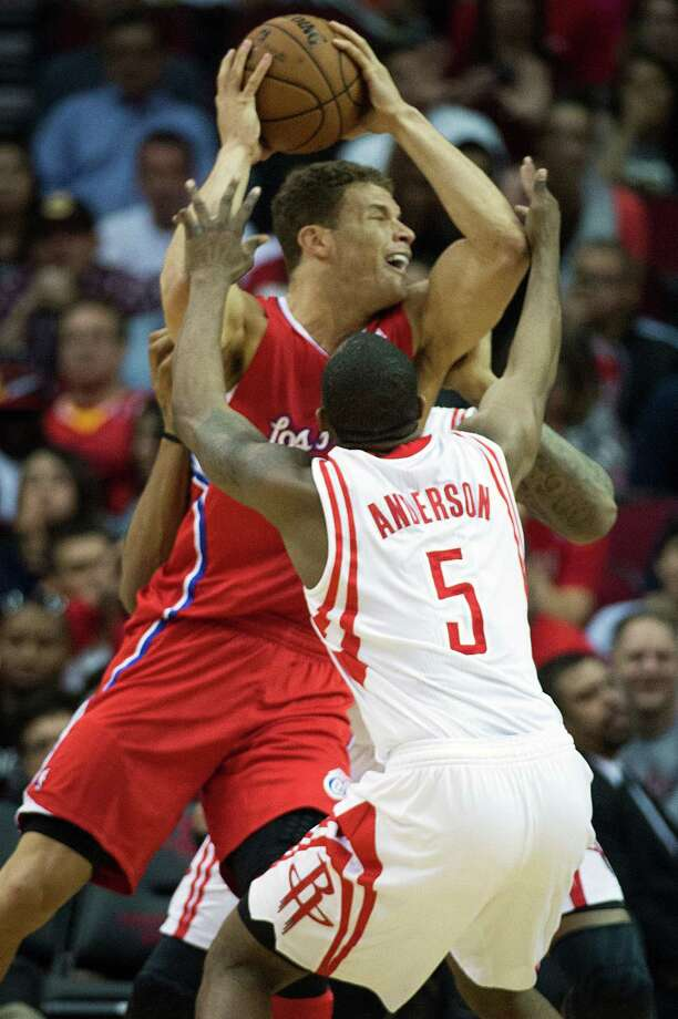 Clippers power forward Blake Griffin is tied up by Rockets guard James Anderson (5) and power forward Greg Smith. Photo: Smiley N. Pool, Houston Chronicle / © 2013  Houston Chronicle