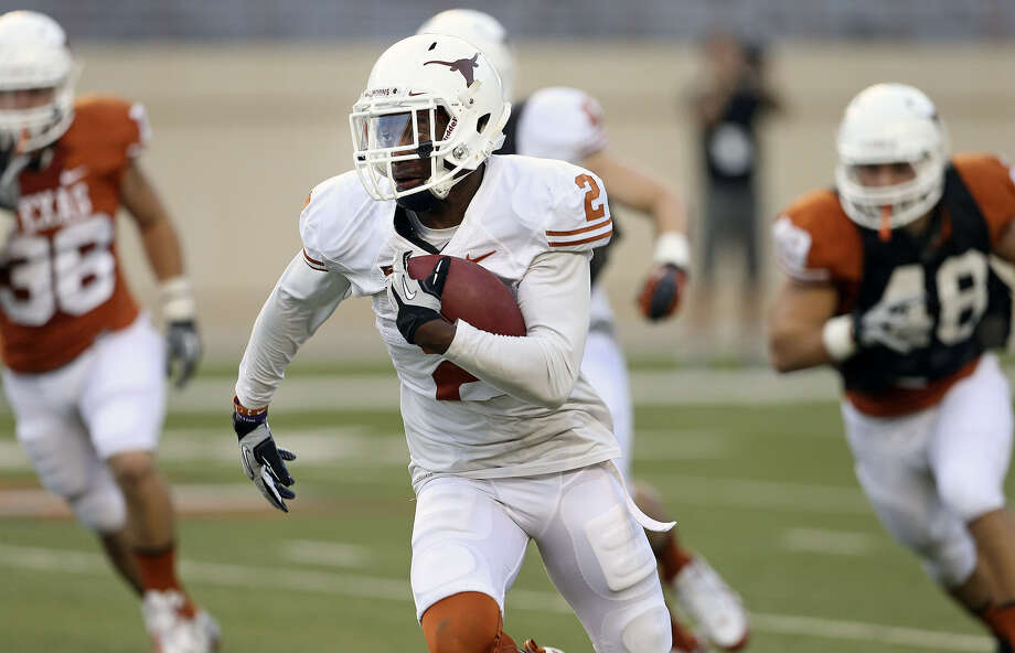 Former Stevens High star Mykkele Thompson takes off on a 61-yard kickoff return for the White team during UT's Orange-White game Saturday in Austin. Photo: Tom Reel / San Antonio Express-News
