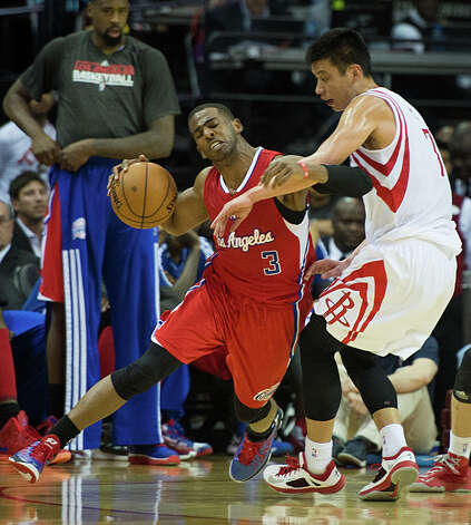 Rockets point guard Jeremy Lin fouls Clippers point guard Chris Paul. Photo: Smiley N. Pool, Houston Chronicle / © 2013  Houston Chronicle
