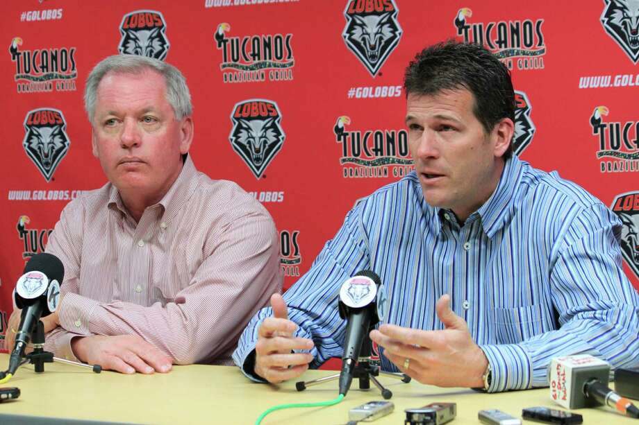 Former New Mexico coach Steve Alford (right) talks about taking the UCLA job as New Mexico athletic director Paul Krebs listens. Photo: Susan Montoya Bryan / Associated Press