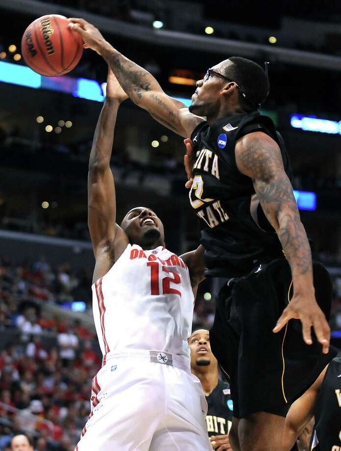Wichita State's Carl Hall blocks the shot of Ohio State's Sam Thompson for one of his six rejections Saturday at Staples Center in Los Angeles. Photo: Wally Skalij / McClatchy-Tribune News Service