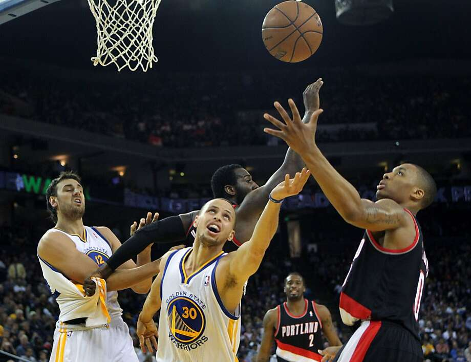 Golden State Warriors guard Stephen Curry (30) loses the ball after being fouled by the Portland Trail Blazers in the first half of their NBA basketball game Saturday, March 30, 2013 at the Oracle Arena in Oakland, California. Photo: Lance Iversen, The Chronicle