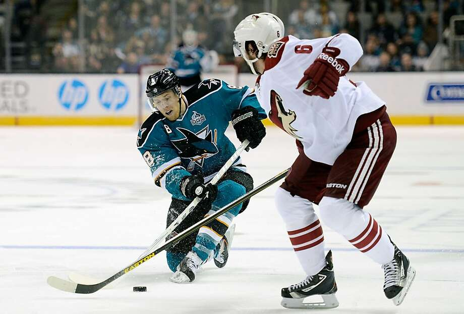 Joe Pavelski (8) passes the puck past David Schlemko. Pavelski scored his 11th goal of the season for the Sharks. Photo: Thearon W. Henderson, Getty Images