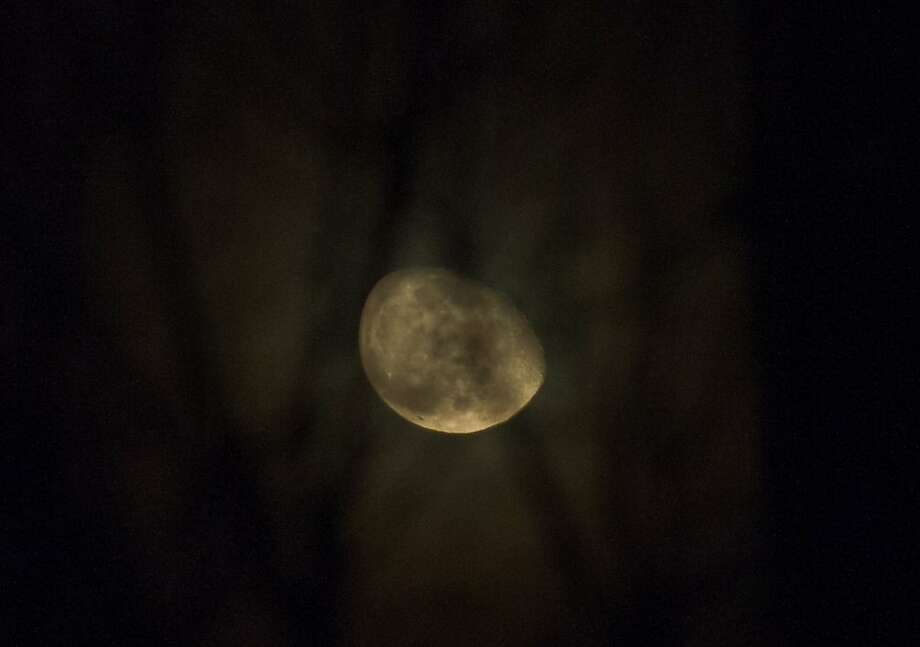 An oblong moon appears above Washington early on March 31, 2013. AFP PHOTO/Nicholas KAMMNICHOLAS KAMM/AFP/Getty Images Photo: Nicholas Kamm, AFP/Getty Images