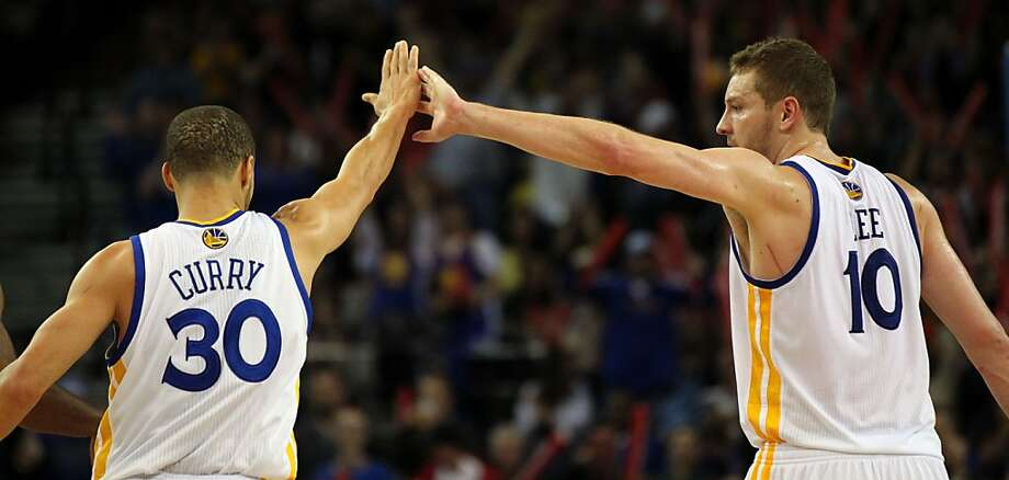 Golden State Warriors guard Stephen Curry (30) is greeted by forward David Lee (10) after Curry hit a three point shot against the Portland Trail Blazers in the second half of their NBA basketball game Saturday, March 30, 2013 in Oakland, Calif. Photo: Lance Iversen, The Chronicle