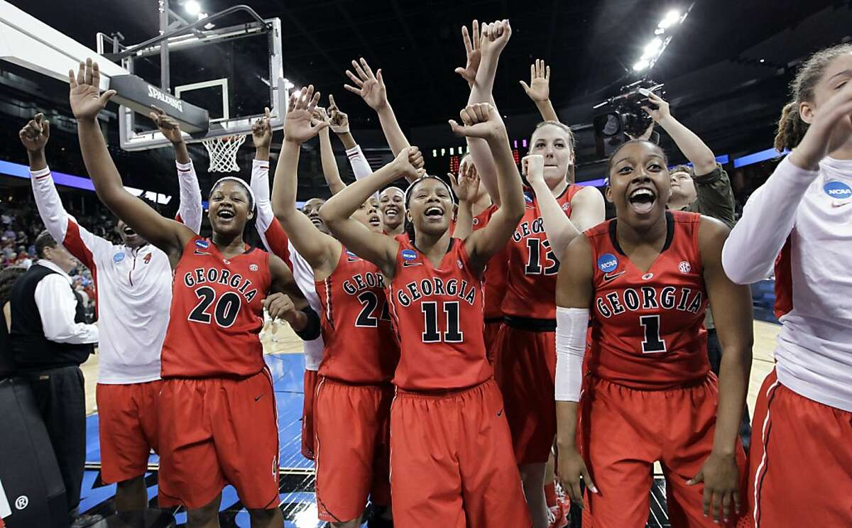 Georgia celebrates after defeating Stanford 61-59 in a regional semifinal in the NCAA women's college basketball tournament Saturday, March 30, 2013, in Spokane, Wash. (AP Photo/Elaine Thompson)