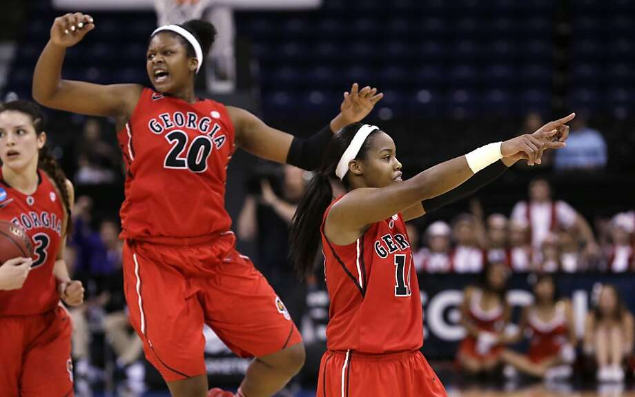 Georgia's Jasmine James, right, motions to fans as Shacobia Barbee (20) celebrates in the final seconds against Stanford in a regional semifinal in the NCAA women's college basketball tournament Saturday, March 30, 2013, in Spokane, Wash. Georgia won 61-59. (AP Photo/Elaine Thompson) Photo: Elaine Thompson, Associated Press