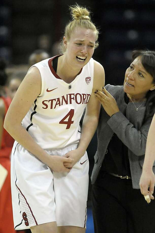Stanford's Taylor Greenfield (4) leaves the court with a hand injury during the first half of Stanford's game against Georgia in a regional semifinal in the NCAA women's college basketball tournament, Saturday, March 30, 2013, in Spokane, Wash. (AP Photo/Jed Conklin) Photo: Jed Conklin, Associated Press