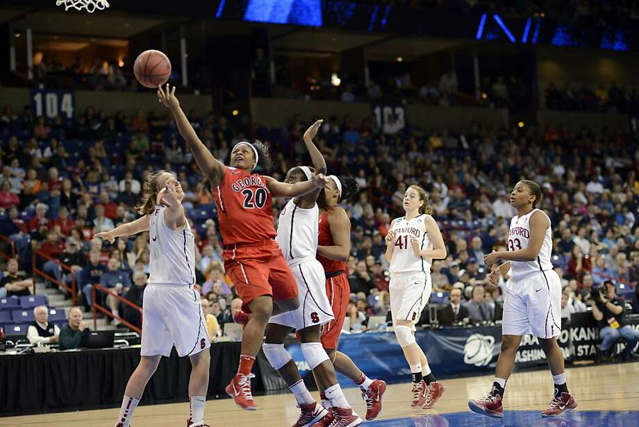 Georgia's Shacobia Barbee (20) drives through Stanford's defense in the first half of a regional semifinal in the NCAA women's college basketball tournament, Saturday, March 30, 2013, in Spokane, Wash. (AP Photo/Jed Conklin) Photo: Jed Conklin, Associated Press