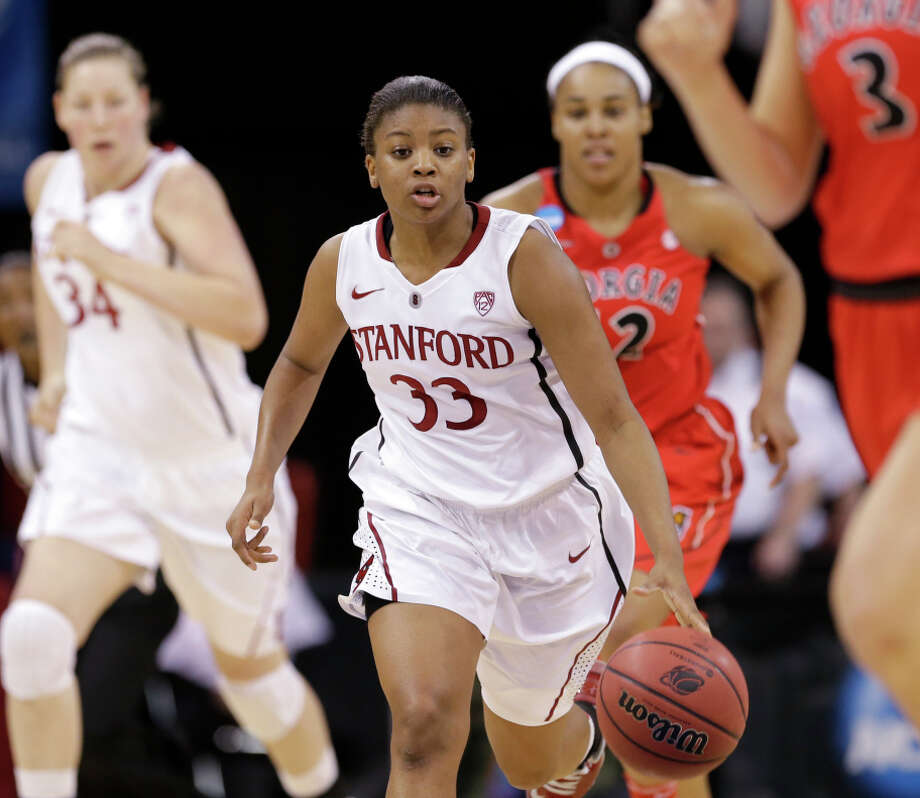 Stanford's Amber Orrange (33) brings the ball up against Georgia in the first half of a regional semifinal in the NCAA women's college basketball tournament Saturday, March 30, 2013, in Spokane, Wash. (AP Photo/Elaine Thompson) Photo: Elaine Thompson / Associated Press / AP