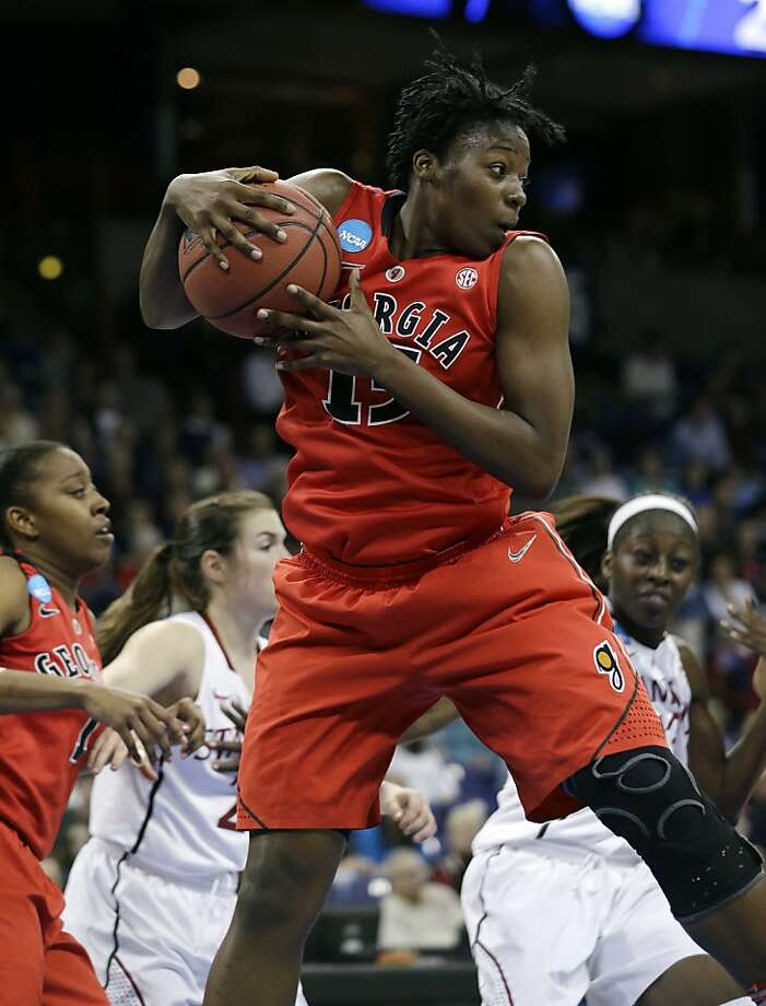 Georgia's Krista Donald comes down with a rebound against Stanford in the first half of a regional semifinal game in the NCAA women's college basketball tournament Saturday, March 30, 2013, in Spokane, Wash. (AP Photo/Elaine Thompson) Photo: Elaine Thompson, Associated Press