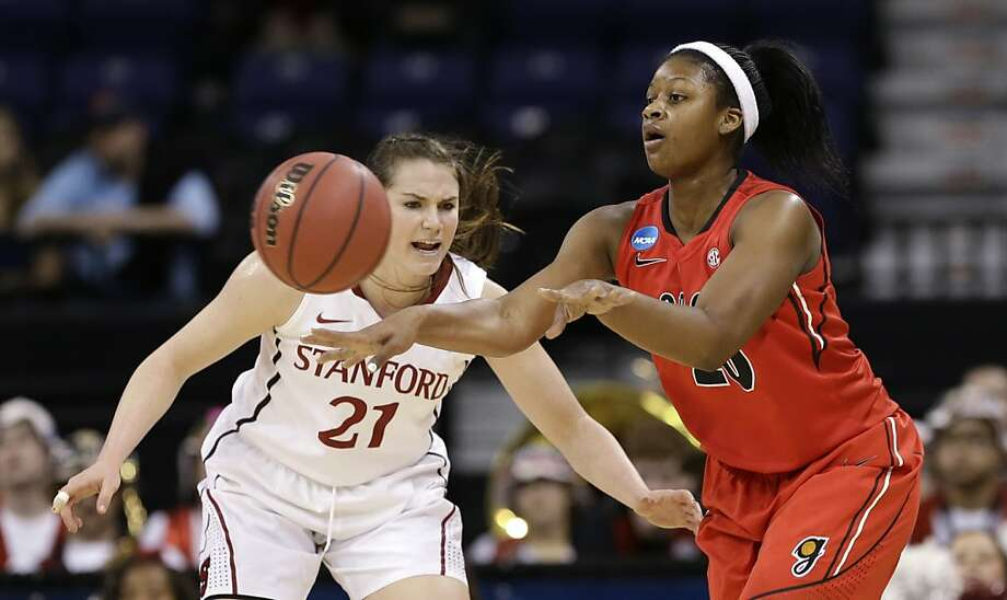 Georgia's Shacobia Barbee, right, passes as Stanford's Sara James defends in the first half of a regional semifinal game in the NCAA women's college basketball tournament Saturday, March 30, 2013, in Spokane, Wash. (AP Photo/Elaine Thompson) Photo: Elaine Thompson, Associated Press