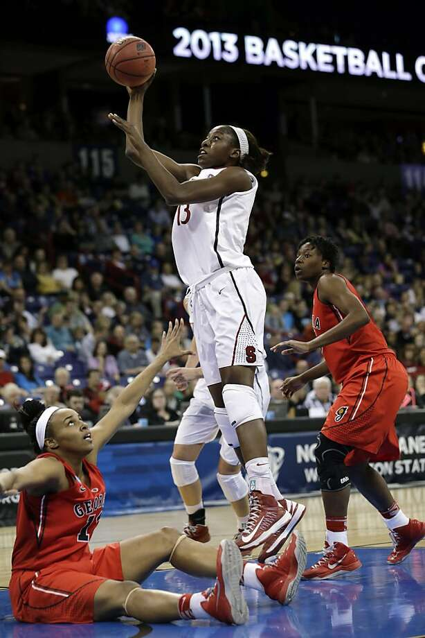 Stanford's Chiney Ogwumike, center, shoot and scores as Georgia's Jasmine Hassell, left, falls to the floor and Krista Donald watches in the first half of a regional semifinal game in the NCAA women's college basketball tournament Saturday, March 30, 2013, in Spokane, Wash. (AP Photo/Elaine Thompson) Photo: Elaine Thompson, Associated Press