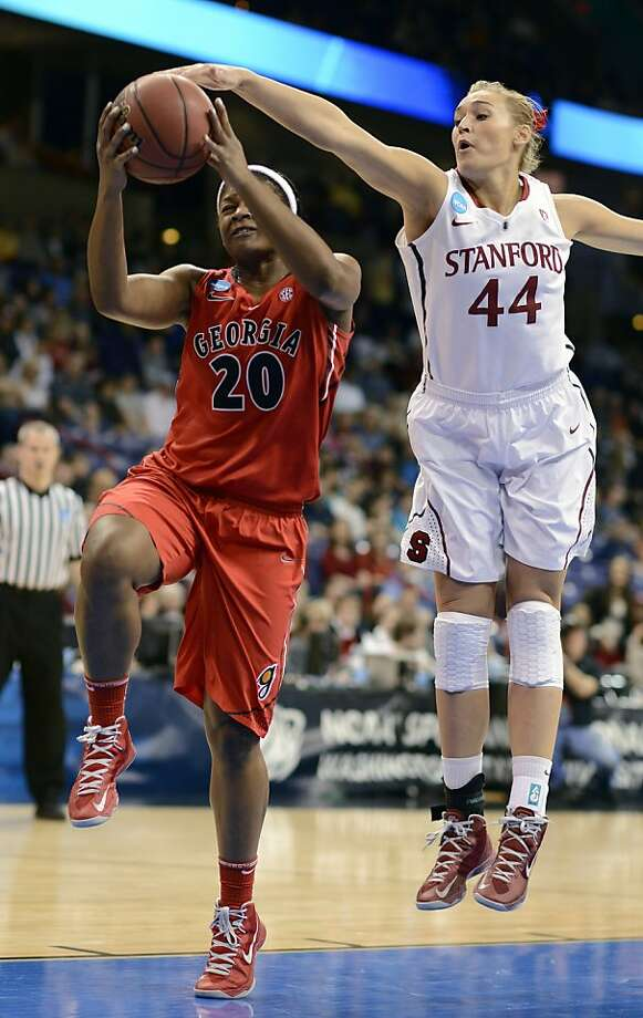 Georgia's Shacobia Barbee (20) makes a drive as Stanford's Joslyn Tinkle (40) gets a hand on the ball in the first half of a regional semifinal in the NCAA women's college basketball tournament, Saturday, March 30, 2013, in Spokane, Wash. (AP Photo/Jed Conklin) Photo: Jed Conklin, Associated Press