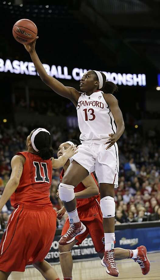 Stanford's Chiney Ogwumike drives past Georgia defenders in the first half of a regional semifinal in the NCAA women's college basketball tournament Saturday, March 30, 2013, in Spokane, Wash. (AP Photo/Elaine Thompson) Photo: Elaine Thompson, Associated Press