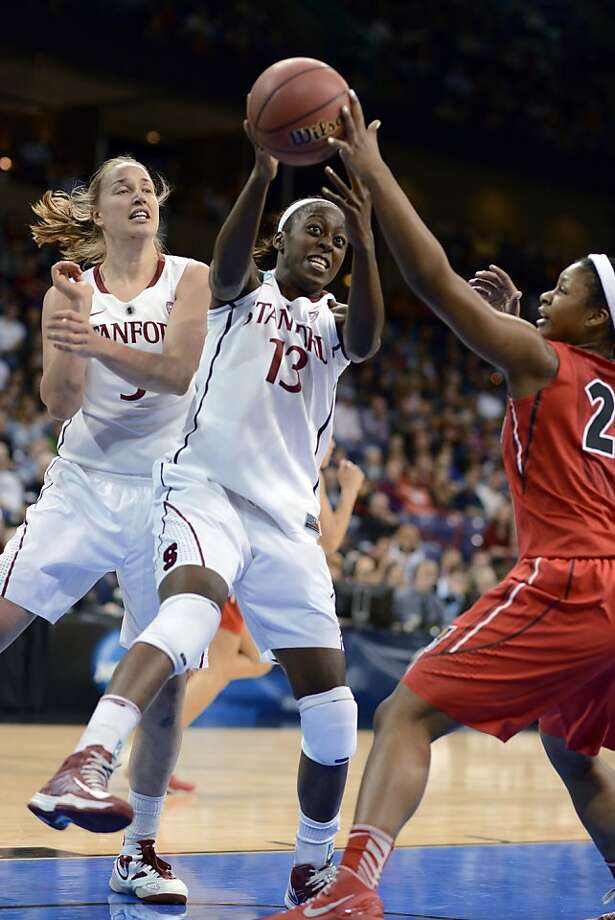 Georgia's Shacobia Barbee goes for a rebound against Stanford's Chiney Ogwumike while Stanford's Mikaela Ruef, left, watches in the first half of a regional semifinal in the NCAA women's college basketball tournament, Saturday, March 30, 2013, in Spokane, Wash. (AP Photo/Jed Conklin) Photo: Jed Conklin, Associated Press