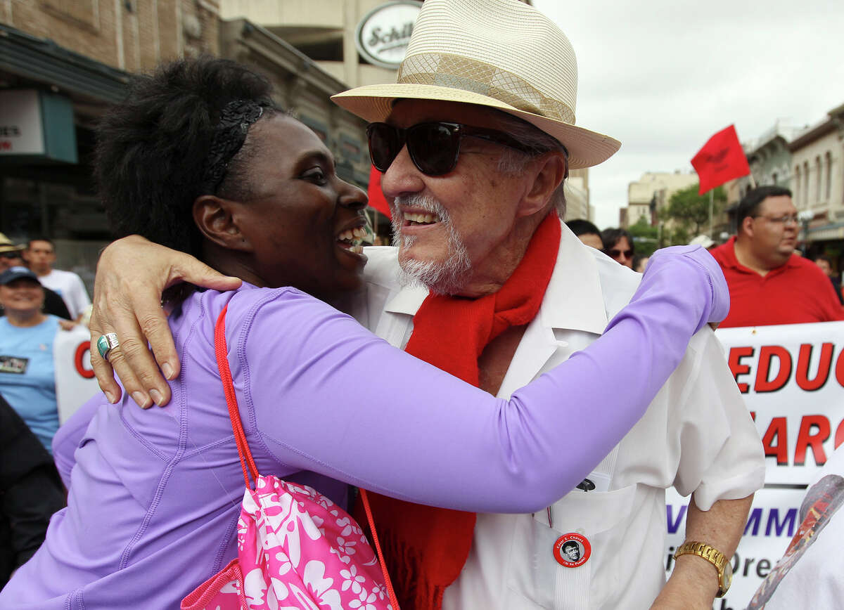 Jaime Martinez (center) of Cesar E. Chavez Legacy and Educational Fund receives a hug while taking part in the 17th annual Cesar Chavez March for Justice through downtown on Saturday, Mar. 30, 2013. Hundreds of people along with and several organizations participated in remembrance of the activist who fought for migrant workers rights.