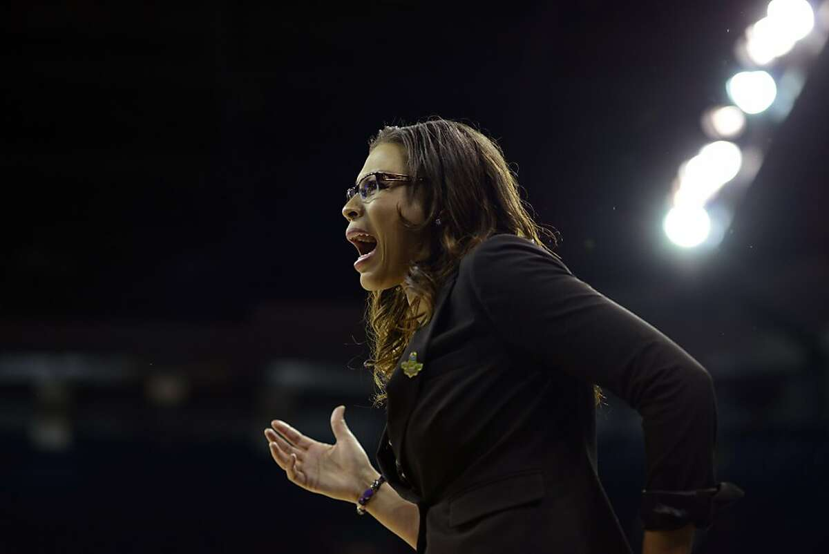 LSU's head coach Nikki Caldwell exchanges words with an official in the first half of a regional semifinal game against California in the NCAA women's college basketball tournament, Saturday March 30, 2013 in Spokane, Wash. (AP Photo/Jed Conklin)