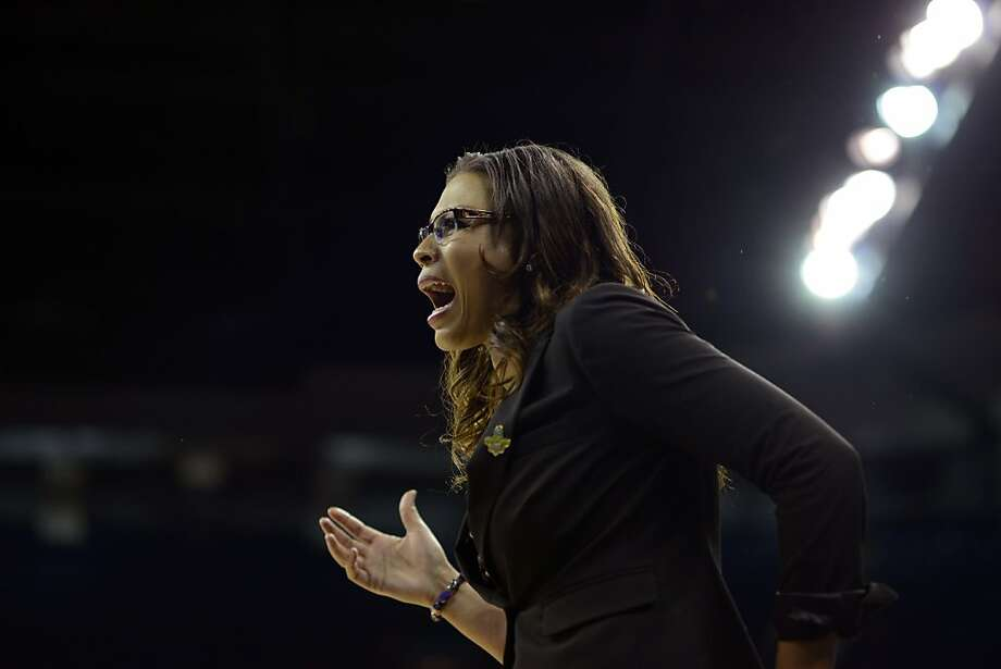 LSU's head coach Nikki Caldwell exchanges words with an official in the first half of a regional semifinal game against California in the NCAA women's college basketball tournament, Saturday March 30, 2013 in Spokane, Wash. (AP Photo/Jed Conklin) Photo: Jed Conklin, Associated Press