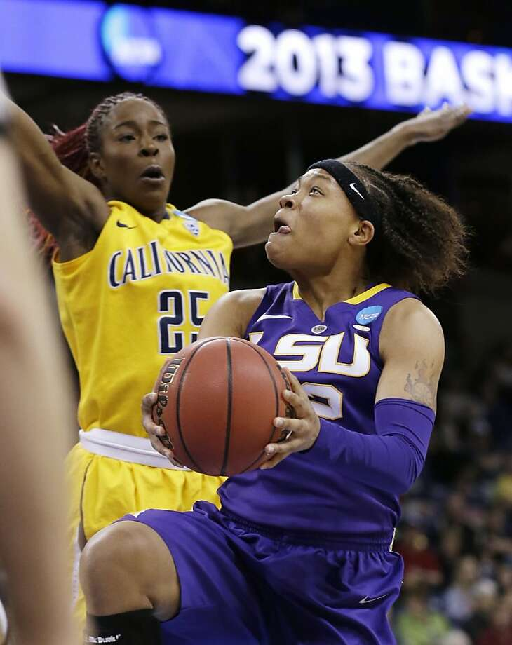 LSU's Danielle Ballard, right, drives to the basket as California's Gennifer Brandon defends in the first half of a regional semifinal in the NCAA women's college basketball tournament Saturday, March 30, 2013, in Spokane, Wash. (AP Photo/Elaine Thompson) Photo: Elaine Thompson, Associated Press