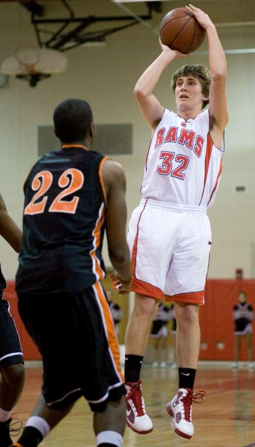 Stamford High School plays New Canaan High School in boys basketball in New Canaan.