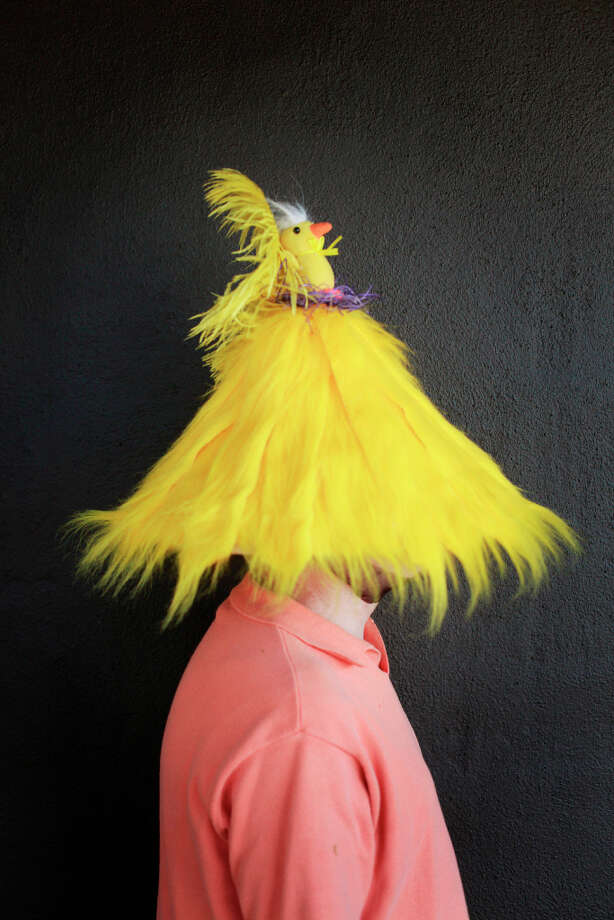 Easter bonnet designer mastermind extraordinaire Joe Mac models his yellow chickadee creation. Photo: Mike Kepka, The Chronicle / ONLINE_YES