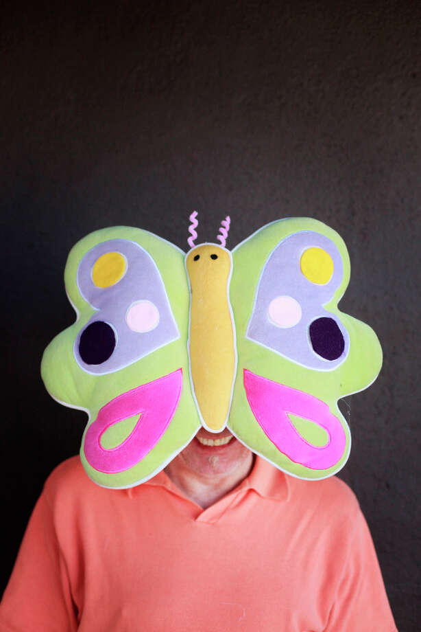 Easter bonnet designer mastermind extraordinaire Joe Mac models his butterfly creation. Photo: Mike Kepka, The Chronicle / ONLINE_YES