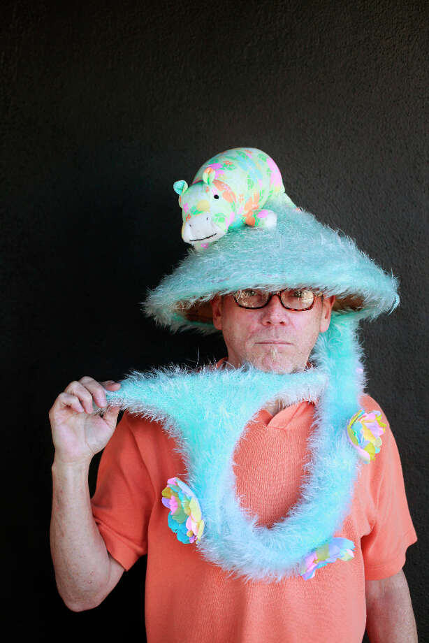 Easter bonnet designer mastermind extraordinaire Joe Mac models his hippopotamus whale tail creation. Photo: Mike Kepka, The Chronicle / ONLINE_YES