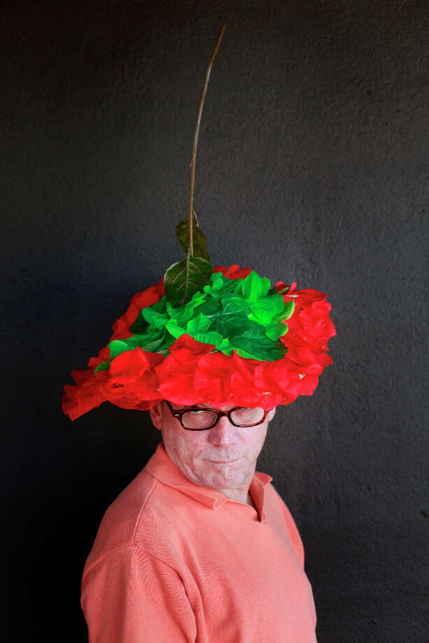 Easter bonnet designer mastermind extraordinaire Joe Mac models his  upside-down rose creation. Photo: Mike Kepka, The Chronicle / ONLINE_YES
